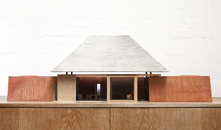 The three blocks are joined by a living space sheltered by a huge timber framed roof.
